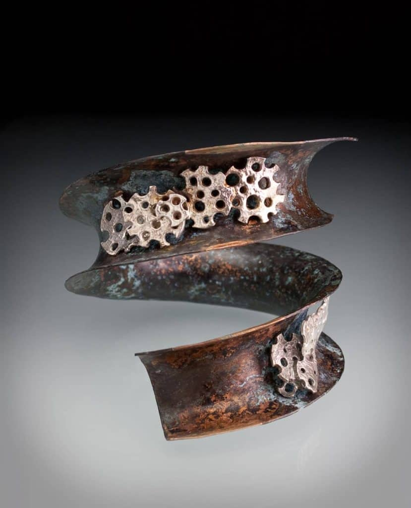 Copper and silver bangle by Julia Rai