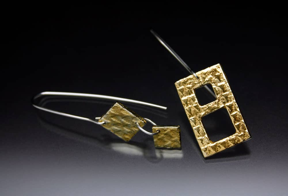 Gold earrings by Julia Rai