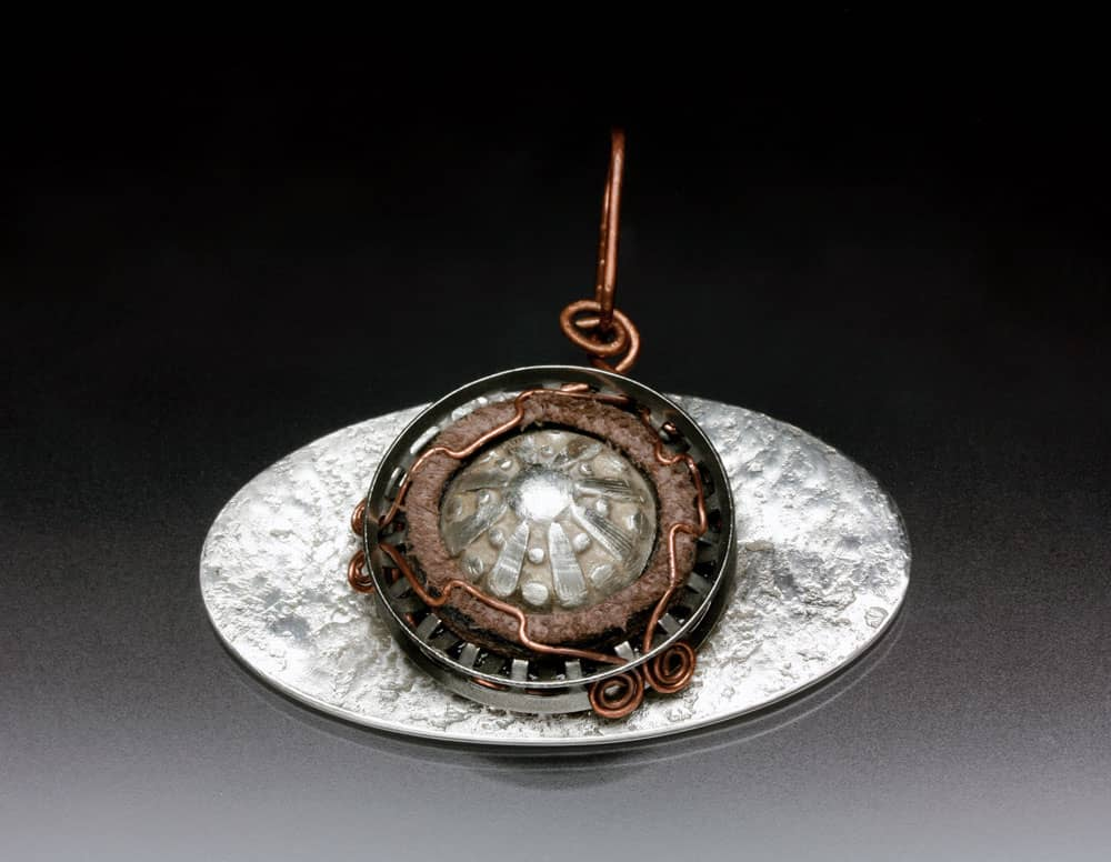 Steel and copper pendant by Julia Rai