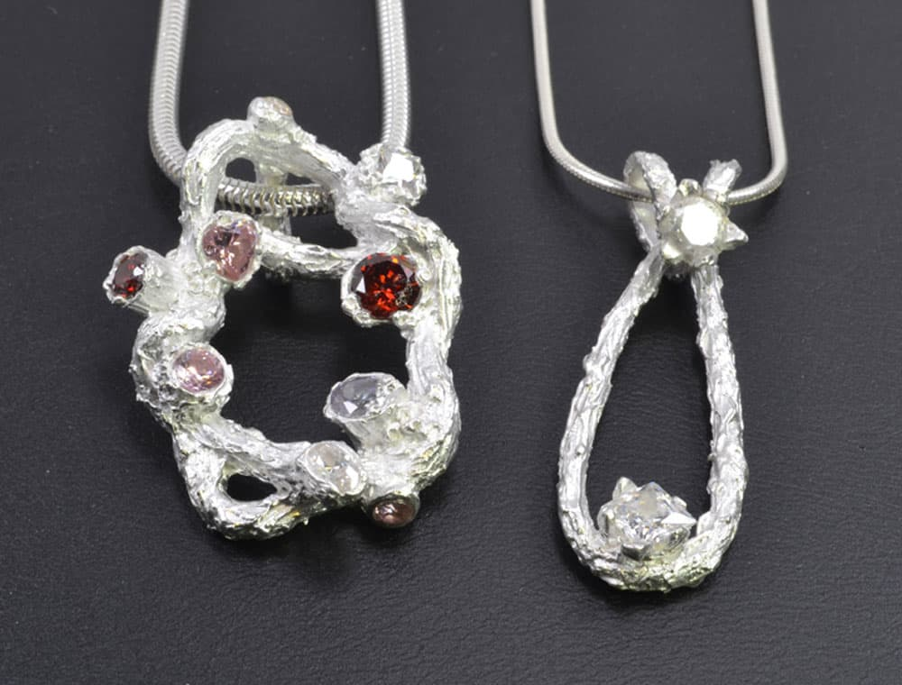 Pendants with fire in place stones by Julia Rai
